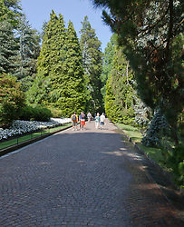 Path into the Villa Taranto Botanical Gardens (Giardini Botanici Villa Taranto) in the town of Pallanza on the western shore of Lake Maggiore. The gardens were established 1931-1940 by Scotsman Neil Boyd McEacharn who bought an existing villa and its neighboring estates, cut down more than 2000 trees, and undertook substantial changes to the landscape, including the addition of major water features employing 8 km of pipes. Today the gardens contain nearly 20,000 plant varieties representing more than 3,000 species, set among 7 km of paths. Among its collections are azalea, cornus, greenhouses of Victoria amazonica, and 300 types of dahlias.mausoleum.
