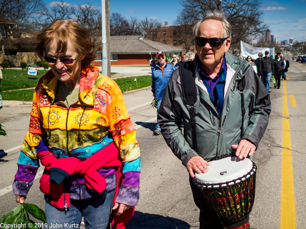 "14 APRIL 2019 - DES MOINES, IOWA: A drummer participates in the Palm Sunday procession for peace in Des Moines. About 200 people participated in an interdenominational  Palm Sunday procession calling for peace. The theme of the procession was ""To Love and Defend our Sacred Earth"" and it was sponsored by Des Moines Faith Committee for Peace.     PHOTO BY JACK KURTZ"