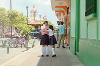 School girls play on the way home in Granada, Nicaragua. Copyright 2017 Reid McNally.
