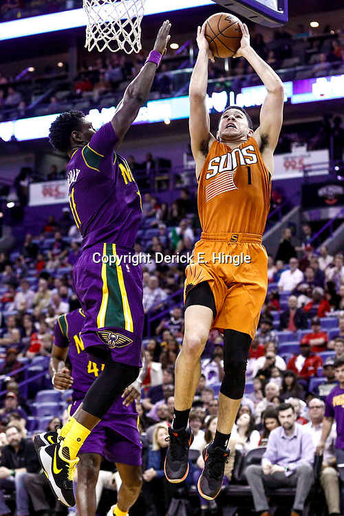 Feb 6, 2017; New Orleans, LA, USA; Phoenix Suns guard Devin Booker (1) shoots over New Orleans Pelicans guard Jrue Holiday (11) during the second half of a game at the Smoothie King Center. The Pelicans defeated the Suns 111-106. Mandatory Credit: Derick E. Hingle-USA TODAY Sports