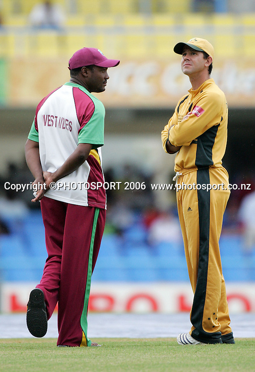 Australian captain Ricky Ponting checks the weather with West Indies captain Brian Lara (L) at the Super 8 Cricket World Cup match, West Indies vs Australia at the Sir Vivian Richards Cricket Ground in Antigua, West Indies on Tuesday 27 March 2007. Australia batted first and scored 322 for 6. Play was called off due to rain and the match will continue tomorrow. Photo: Andrew Cornaga/PHOTOSPORT<br />
