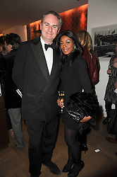 WILLIAM CASH and PHOEBE VELA at a party to celebrate the launch of 'Interiors by Yoo' - a book by John Hitchcox, Philippe Starck, Kelly Hoppen, Jade Jagger and Marcel Wanders held at Selfridges, 400 Oxford Street, London on 3rd December 2009.