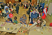 Cape May art and cookie community party with multi racial children making cookies with adults in decorated gymnasium Family activities Children, Foods,