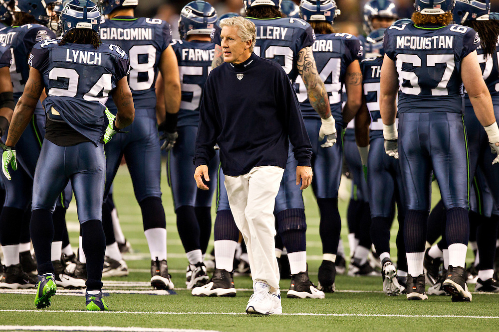 ARLINGTON,  TX - NOVEMBER 6:   Head Coach Pete Carroll of the Seattle Seahawks watches his team warm up before a game against the Dallas Cowboys at Cowboys Stadium on November 6, 2011 in Arlington, Texas.  The Cowboys defeated the Seahawks 23 to 13.  (Photo by Wesley Hitt/Getty Images) *** Local Caption *** Pete Carroll