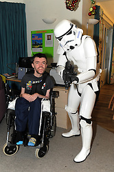 Star Wars, Rachel House, Kinross, 11-12-2016<br /> <br /> People dressed as Star Wars characters to visit children's hospice. Edinburgh 's Capital Sci-Fi Con organiser Keith Armour and other delegates to don costumes and visit children and their families at Rachel House.<br /> <br /> Alistair with a Storm Trouper<br /> <br /> (c) David Wardle | Edinburgh Elite media