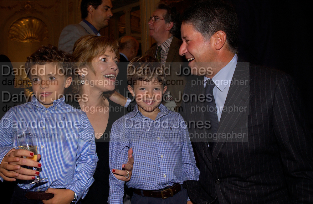 Flora Fraser with her husband Peter Soros and  sons Simon and Tommy Soros, Flora Fraser launch party for her book ' Princesses the Daughters of George 111' the Savile club, Brook St. 14 September 2004. SUPPLIED FOR ONE-TIME USE ONLY-DO NOT ARCHIVE. © Copyright Photograph by Dafydd Jones 66 Stockwell Park Rd. London SW9 0DA Tel 020 7733 0108 www.dafjones.com