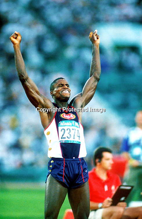 Carl Lewis celebrates after finishing his race. Atlanta Olympics, 1996. Photo: Andrew Cornaga/PHOTOSPORT