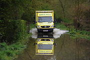 An ambulance drives through flood after an accident in Tewkesbury  on May 1st 2012 as UK record rainfall causes flooding..Photo Times Photographer /Ki Price .....
