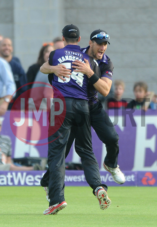 Peter Handscomb of Gloucestershire celebrates with Benny Howell of Gloucestershire after catching out Johann Myburgh of Somerset for 63 - Photo mandatory by-line: Dougie Allward/JMP - Mobile: 07966 386802 - 19/06/2015 - SPORT - Cricket - Bristol - County Ground - Gloucestershire v Somerset - Natwest T20 Blast
