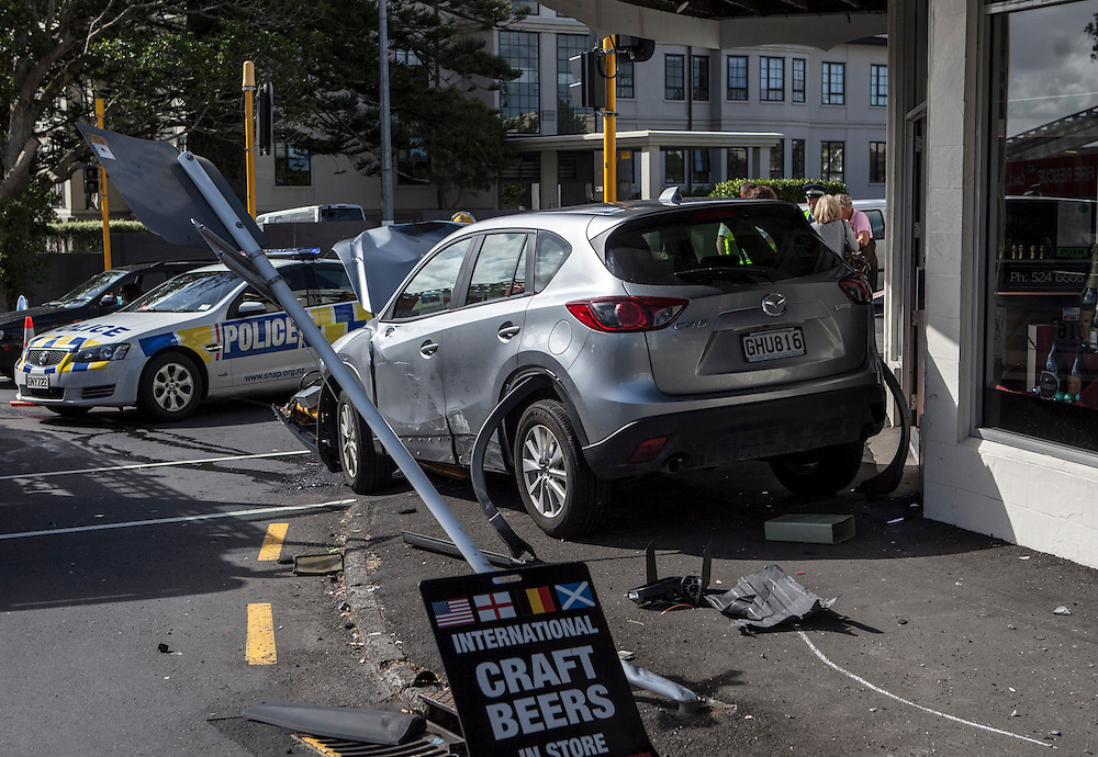 Emergency services attend a vehicle crash in Remuera after a car smashed into a number of shops with an occupant being transported to hospital for observation, Auckland, New Zealand, Saturday, December 07, 2013. Credit:SNPA / Bradley Ambrose