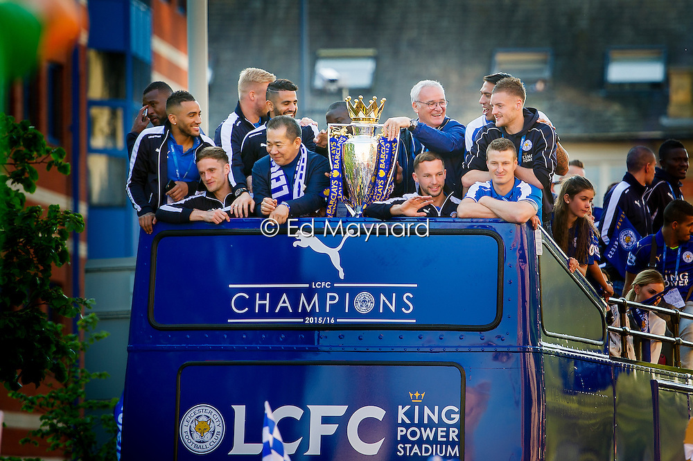 Claudio Ranieri holds the trophy surrounded by players (clockwise from Ranieri) Leonardo Ulloa, Jamie Vardy, Robert Huth, Danny Drinkwater, chairman Vichai Srivaddhanaprabha, Andy King, Danny Simpson, Wes Morgan, Kasper Schmeichel (obscured) and Riyad Mahrez, during Leicester City Football Club victory parade after winning the Premiership title, Leicester, England, UK.<br /> Photo: Ed Maynard<br /> 07976 239803<br /> www.edmaynard.com