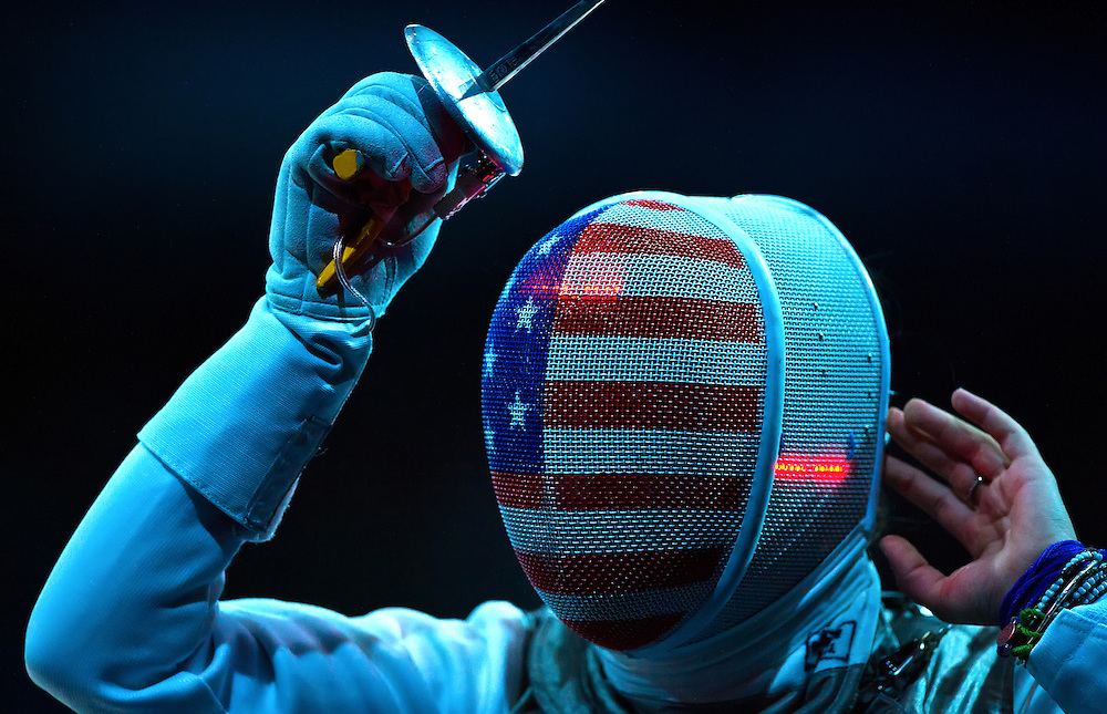 Nicole Ross of the United States adjusted her mask during the women's team foil quarterfinals against Korea at the ExCel centre during the 2012 Summer Olympic Games in London, England, Thursday, August 2, 2012. Korea advanced over the United States with a 45-31 win. (David Eulitt/Kansas City Star/MCT)
