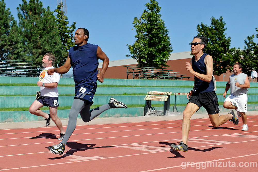(L to R) Michael Gray, Ivan Moody, Peter Chen, and Val Rivers competing in the mens 50-54 age group 100 meter dash during the Idaho Senior Games at Northwest Nazarene University in Nampa, Idaho on August 21, 2010.<br /> <br /> Moody won the race in 13.5 followed by Chen (13.8), Gray (13.9) and Rivers (15.4).