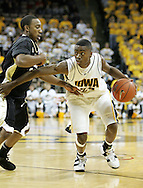 26 NOVEMBER 2007: Iowa guard Justin Johnson (24) tries to get around Wake Forest guard Jeff Teague (0) in Wake Forest's 56-47 win over Iowa at Carver-Hawkeye Arena in Iowa City, Iowa on November 26, 2007.