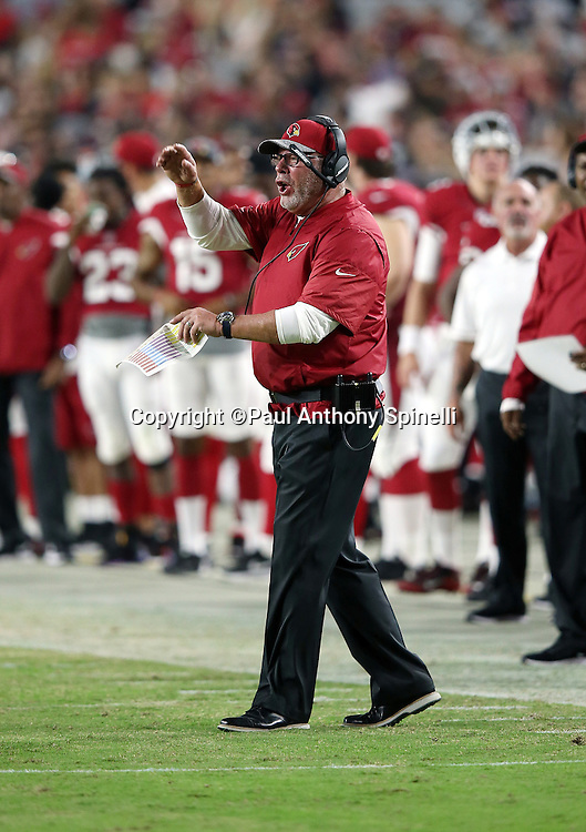 Arizona Cardinals head coach Bruce Arians yells out as he gestures from the sideline during the 2016 NFL preseason football game against the Oakland Raiders on Friday, Aug. 12, 2016 in Glendale, Ariz. The Raiders won the game 31-10. (©Paul Anthony Spinelli)