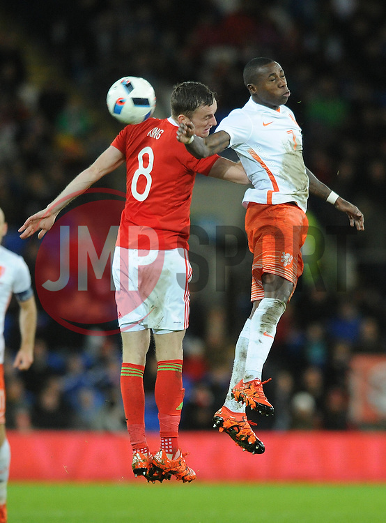 Andy King of Wales challenges for the header with Jeffry Bruma of The Netherlands - Mandatory byline: Dougie Allward/JMP - 07966 386802 - 13/11/2015 - FOOTBALL - Cardiff City Stadium - Cardiff, Wales - Wales v Netherlands - International Friendly