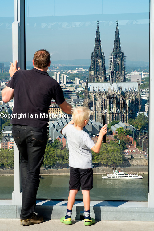 Father and son looking at  skyline and Cathedral from observation platform  in Cologne Germany