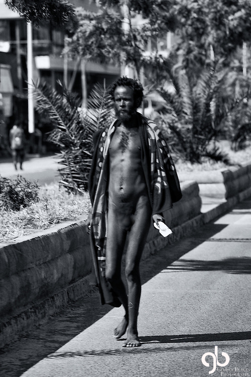 """I was in Adama, Ethiopia when I saw this streaker.  I asked our guide what that was all about.  He thought for a moment and settled on this conclusion, """"he's mad - crazy"""".  BTW:  I used a blur tool to discretely present this image."""