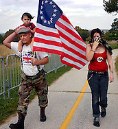 VALLEY FORGE, PA - SEPTEMBER 25: An family of American Nazi party members arrives for an American Nazi rally at Valley Forge National Park September 25, 2004 in Valley Forge, Pennsylvania. Hundreds of American Nazis from around the country were expected to attend. (Photo by William Thomas Cain/Getty Images)