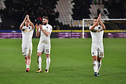 Leeds United player Adam Forshaw (4), Leeds United midfielder Stuart Dallas (15) and Leeds United defender Gaetano Berardi (28) at end of the EFL Sky Bet Championship match between Hull City and Leeds United at the KCOM Stadium, Kingston upon Hull, England on 30 January 2018. Photo by Ian Lyall.