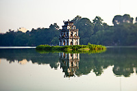 "A ""Turtle Tower"" pagoda in the center of Hoan Kiem lake in downtown Hanoi, Vietnam. Legend has it that the pagoda sits atop a giant turtle's back in the lake."
