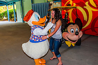 Teenaged girl with Donald Duck, Fantasia Gardens Pavilion, Walt Disney World, Orlando, Florida USA
