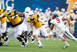 Sep 12, 2015; Morgantown, WV, USA; West Virginia Mountaineers quarterback Skyler Howard runs the ball against the Liberty Flames at Milan Puskar Stadium. Mandatory Credit: Ben Queen-USA TODAY Sports