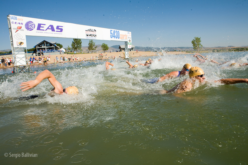 Athletes competing in the swimming leg of the Boulder Peak Triathlon in Boulder, CO