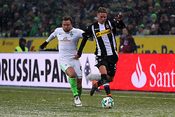 MOENCHENGLADBACH, March 3, 2018  Philipp Bargfrede (L) of Bremen vies with Nico Elvedi of Moenchengladbach during the Bundesliga match between Borussia Moenchengladbach and SV Werder Bremen at Borussia-Park in Moenchengladbach, Germany, on March 2, 2018.  The match ended with a 2-2 draw. (Credit Image: © Ulrich Hufnagel/Xinhua via ZUMA Wire)