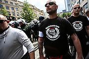 Frankfurt am Main | 20 Jun 2015<br /> <br /> Kundgebung der islamfeindlichen Gruppe &quot;Widerstand Ost West&quot; (WOW) um Ester Seitz, die Rechtspopulisten, rechte Hooligans und Neonazis vereint, auf dem Rossmarkt.<br /> Hier: Ein Hooligan mit einem T-Shirt mit der Aufschrift &quot;B&uuml;ndnis Deutscher Hooligans Berlin&quot;.<br /> <br /> Photo &copy; peter-juelich.com