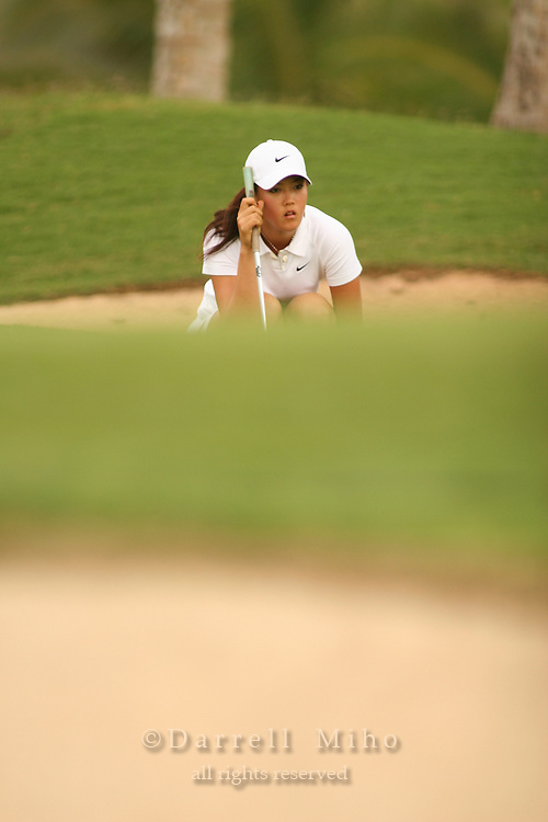 Feb 24, 2006; Kapolei, HI, USA; Michelle Wie studies her putting line during the 2nd round of the LPGA Fields Open at Ko Olina Resort...Photo Credit: Darrell Miho.Copyright © 2006 Darrell Miho