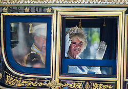 © Licensed to London News Pictures. 27/05/2015. London, UK. Prince Charles and Camilla, Duchess of Cornwall travel in a horse drawn carriage from Buckingham Palace in front of Elizabeth Clock Tower and the houses of parliament to attend State Opening of Parliament in London on May 27, 2015. Photo credit: Ben Cawthra/LNP