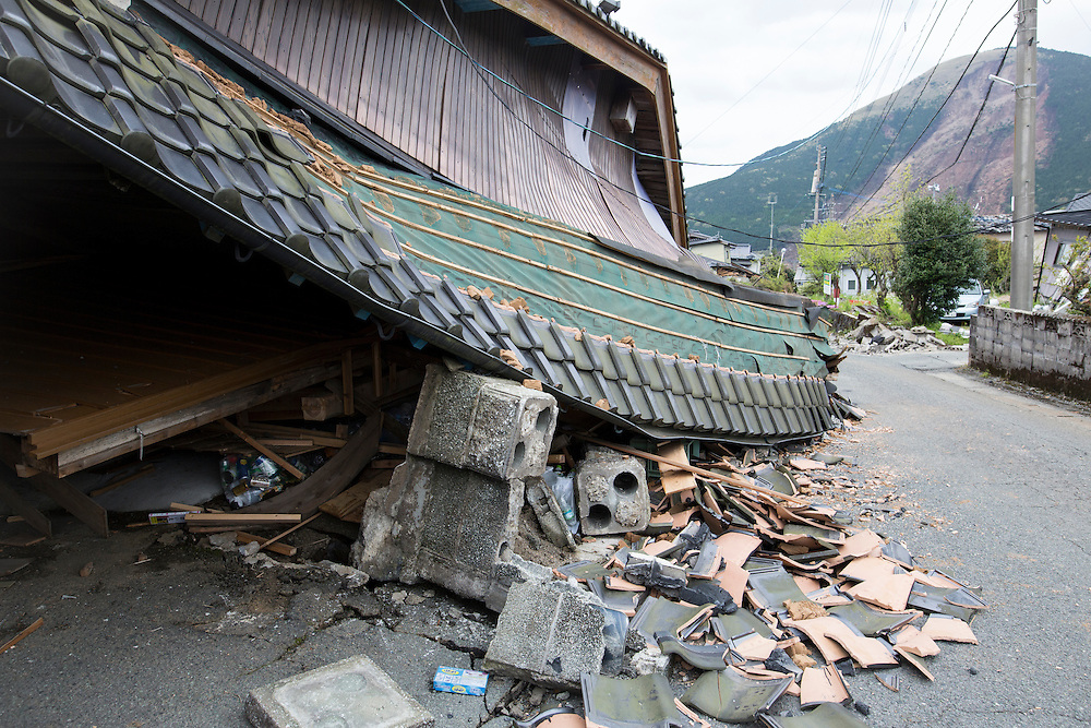 KUMAMOTO, JAPAN - APRIL 18: A collapsed house is seen after an earthquake on April 18, 2016 in Mashiki, Kumamoto, Japan. At least nine people have died in a powerful earthquake, with a preliminary magnitude of 6.4, and followed by magnitude 7.3 quake that struck Kumamoto Prefecture yesterday.<br /> <br /> Photo: Richard Atrero de Guzman