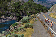 Cyclists ride along a curve during a group bicycle ride at the week-long Cycle Greater Yellowstone tour.