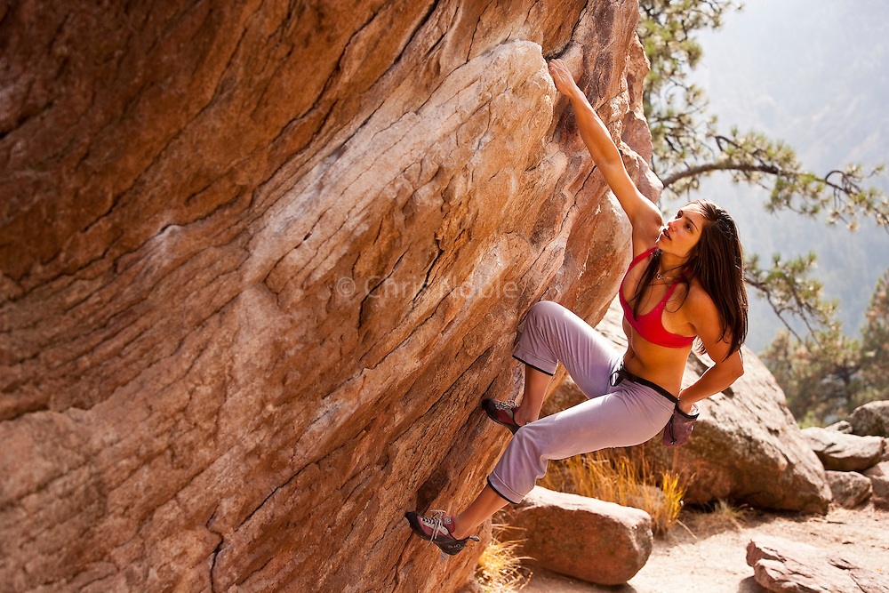 Climbing competitor Alex Puccio bouldering on Flagstaff Mountain near her home town of Boulder Colorado.