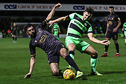 Mansfield Town's Malvind Benning(3) and Forest Green Rovers Liam Shephard(2) battle for the ball during the EFL Sky Bet League 2 match between Forest Green Rovers and Mansfield Town at the New Lawn, Forest Green, United Kingdom on 29 January 2019.