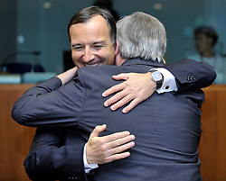 "Franco Frattini, Italy's foreign minister, greets Jean-Claude Juncker, Luxembourg's prime minister, during the European Union Summit at the EU headquarters in Brussels, Belgium, on Thursday, Oct. 29, 2009. European Union leaders are set for ""very difficult"" talks to overcome the Czech Republic's resistance to a new governing treaty designed to strengthen the EU's influence in world affairs, Reinfeldt said. (Photo © Jock Fistick)"