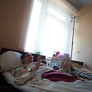 An injured pro-Russian activist, supposedly shot in the leg by Ukrainian soldiers, lies in a bed at a hospital in central Mariupol, hours after deadly confrontations between armed separatist group and the national army.