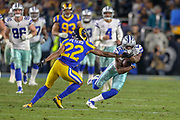 Jan 12, 2019; Los Angeles, CA, USA;  Dallas Cowboys wide receiver Michael Gallup (13) is defended by Los Angeles Rams cornerback Marcus Peters (22) during an NFL divisional playoff game at the Los Angeles Coliseum. The Rams beat the Cowboys 30-22. (Kim Hukari/Image of Sport)