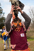 A costumed reveler holds up the chicken he caught during the Faquetigue Courir de Mardi Gras chicken run on Fat Tuesday February 17, 2015 in Eunice, Louisiana. The traditional Cajun Mardi Gras involves costumed revelers competing to catch a live chicken as they move from house to house throughout the rural community.