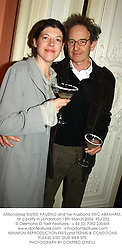 Millionairess SIGRID RAUSING and her husband ERIC ABRAHAM, at a party in London on 15th March 2004.PSJ 222