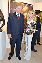 RICHARD & BASIA BRIGGS at a private view of the exhibition Transcending Boundaries 2015 held at Lacey Contemporary Gallery, Clarendon Cross, Notting Hill, London on 30th April 2015.