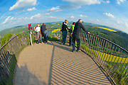 RATHEN, GERMANY - MAY 23, 2010: Unidentified tourists enjoy panoramic view to Elbe river and Saxon Switzerland from Bastei view point in Rathen, Germany.