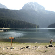 """Lake in Durmitor park. There are several arguments about the derivation of the name  """"Montenegro"""", one of these relates to dark and deep forests  that once covered the Dinaric Alps, as it was possible to see them from the sea. <br /> Mostly mountainous with 672180 habitants on an area of 13812 Km², with a population density of  48 habitants/Km². <br /> It borders with Bosnia, Serbia, Croatia, Kosovo and Albania but  Montenegro has always been alien to the bloody political events that characterized Eastern Europe in recent decades. <br /> From 3 June 2006, breaking away from Serbia, Montenegro became an independent state. <br /> In the balance between economy devoted to sheep farming and a shy tourist, mostly coming from Bosnia and Herzegovina, Montenegro looks to Europe with a largely unspoiled natural beauty. <br /> Several cities in Montenegro, as well as the park Durmitor, considered World Heritage by UNESCO but not yet officially because Montenegro has yet to ratify the World Heritage Convention of UNESCO."""