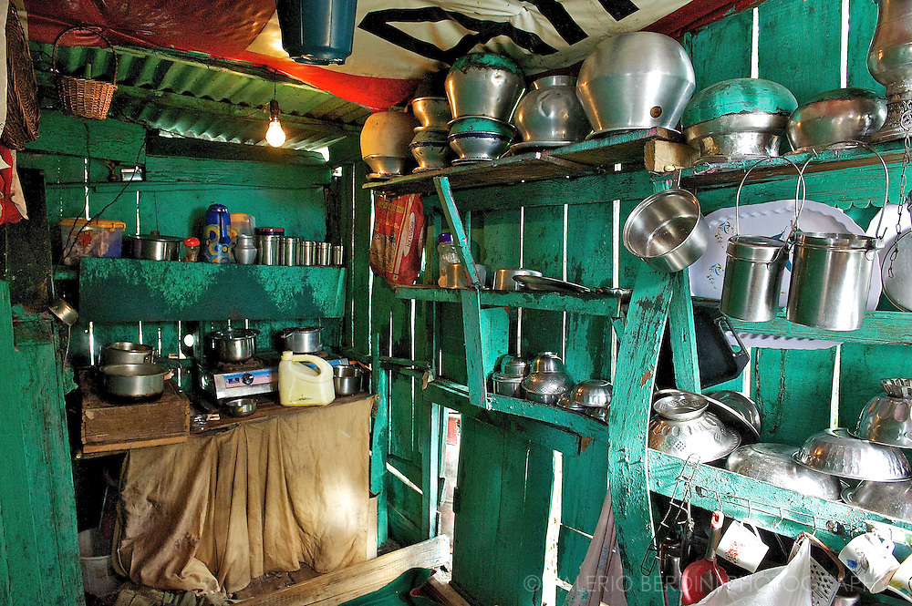 The kitchen of one of the houseboats floating on the Dal Lake. Kashmir. India