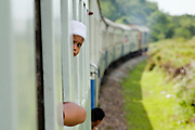 "Sept 26, 2009 -- PATTANI, THAILAND: A Muslim boy rides the train from Pattani to Yala in Thailand. Thailand's three southern most provinces; Yala, Pattani and Narathiwat are often called ""restive"" and a decades long Muslim insurgency has gained traction recently. Nearly 4,000 people have been killed since 2004. The three southern provinces are under emergency control and there are more than 60,000 Thai military, police and paramilitary militia forces trying to keep the peace battling insurgents who favor car bombs and assassination.  Photo by Jack Kurtz / ZUMA Press"