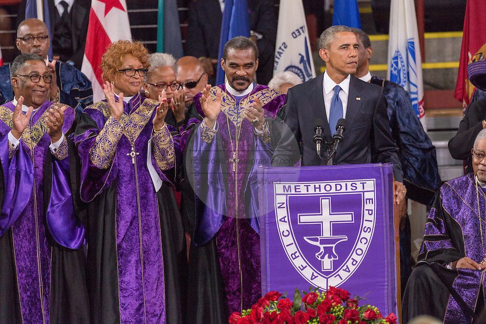 U.S. President Barack Obama surrounded by Bishops from the AME Church delivers the eulogy at the funeral of slain State Senator Clementa Pinckney at the TD Arena June 24, 2015 in Charleston, South Carolina. Pinckney is one of the nine people killed in last weeks Charleston church massacre.