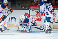 PENTICTON, CANADA - SEPTEMBER 8: Dylan Wells #30 of Edmonton Oilers makes a second period save Calgary Flames on September 8, 2017 at the South Okanagan Event Centre in Penticton, British Columbia, Canada.  (Photo by Marissa Baecker/Shoot the Breeze)  *** Local Caption ***