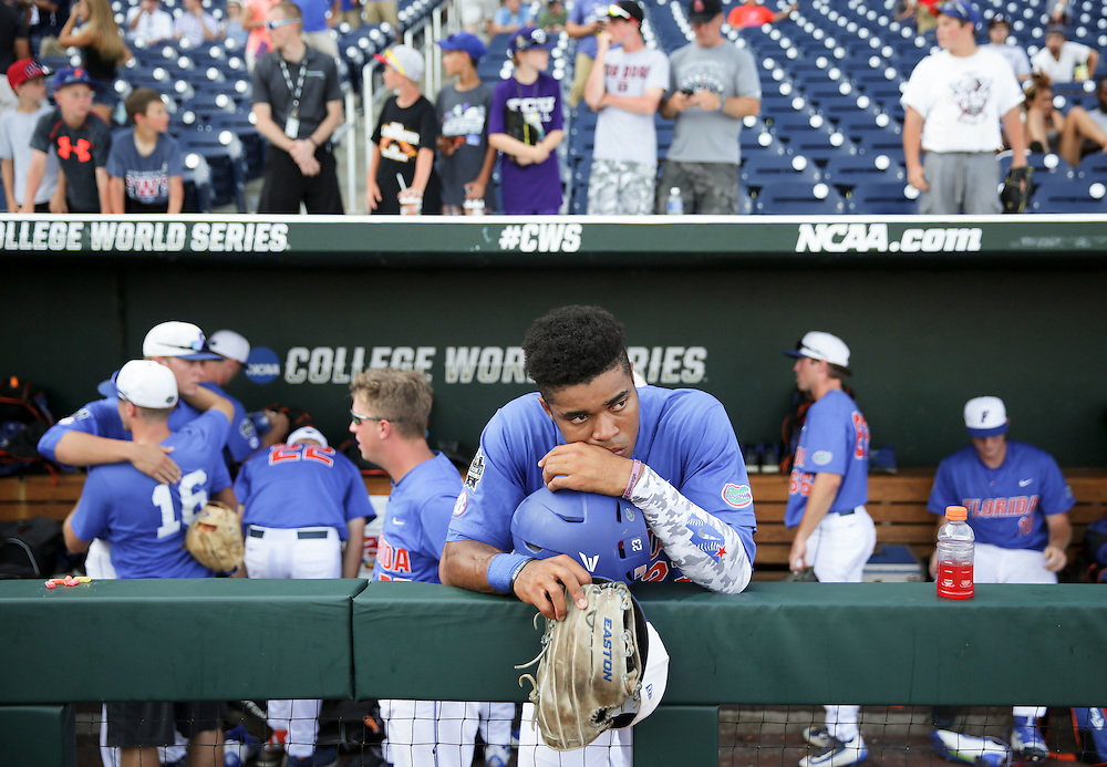 OMAHA, NEB.  -- 06/21/2016:   Florida's Buddy Reed (23) reacts to the Gators' 3-2 loss to Texas Tech and their elimination from the College World Series at TD Ameritrade Park in Omaha, Neb., Tuesday, June 21, 2016.<br /> MATT DIXON/THE WORLD-HERALD