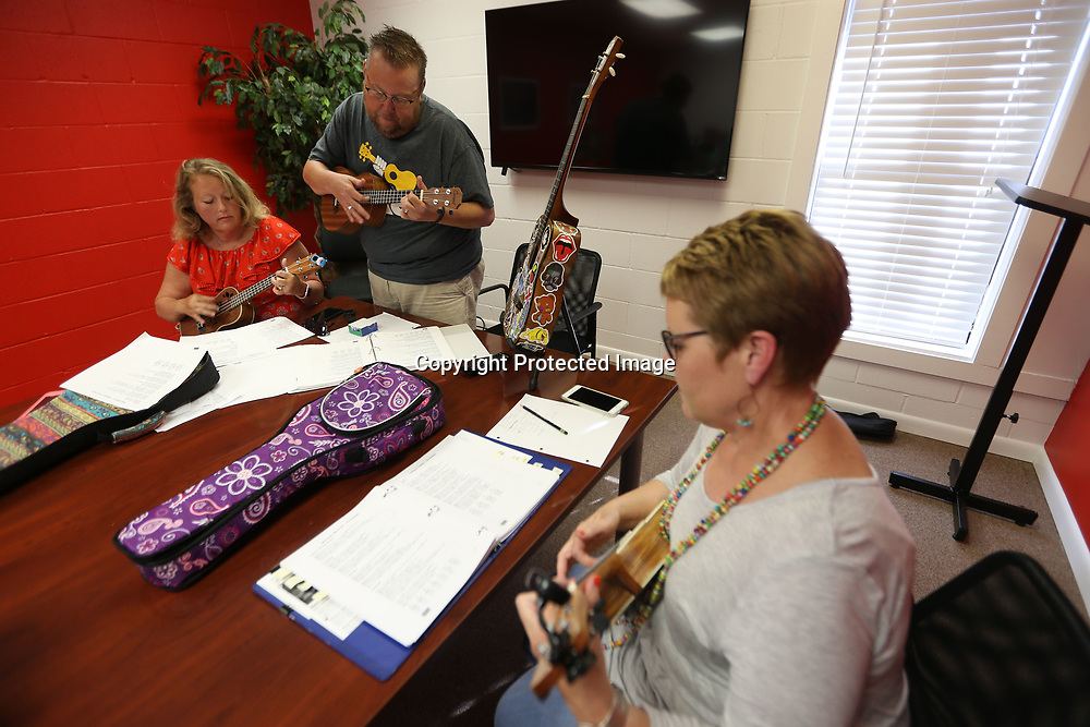Dana and Mark Maharrey, of Tupelo, along with Phyllis Dye, of Brewer, practice the Ukulele.